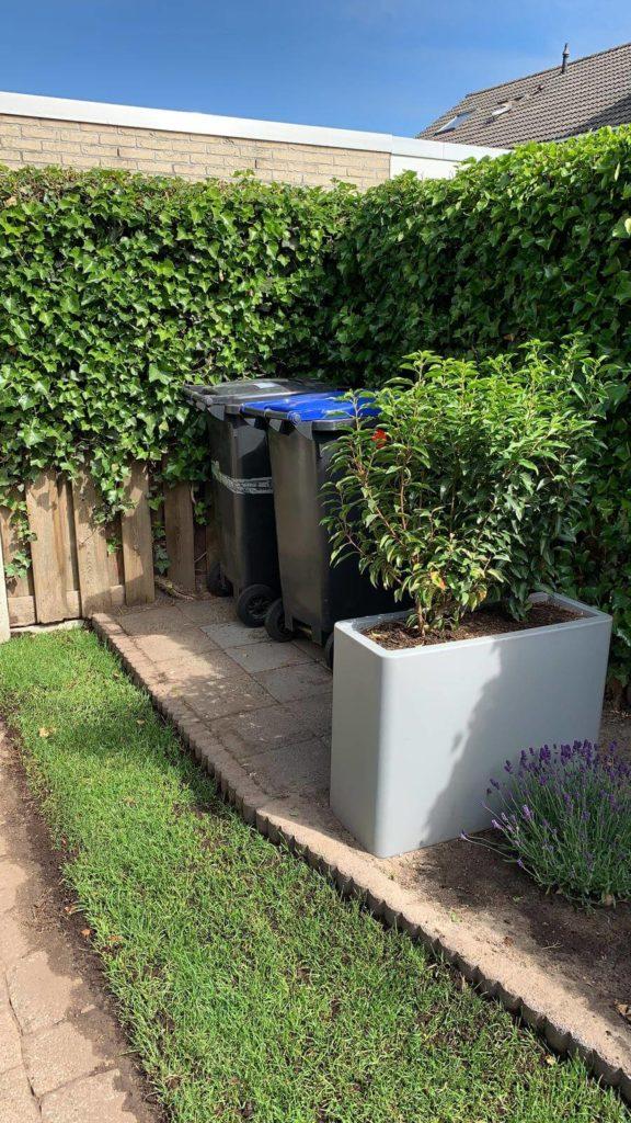 Container wegwerken in de tuin